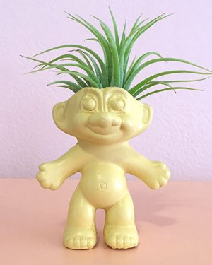 troll doll cement planter